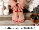 beautiful female feet at spa...   Shutterstock . vector #628939373
