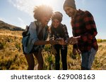 group of hikers looking at... | Shutterstock . vector #629008163
