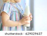 cute little girl with bottle of ... | Shutterstock . vector #629029637
