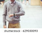 the young man holding tablet... | Shutterstock . vector #629030093