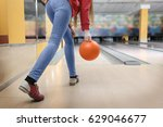 young woman throwing ball in... | Shutterstock . vector #629046677