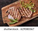 grilled beef steak on wooden... | Shutterstock . vector #629080367