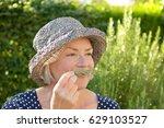 senior woman in blue polka... | Shutterstock . vector #629103527