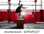 fit young man jumping onto a... | Shutterstock . vector #629109227