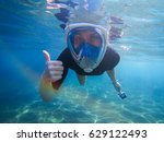 Snorkeling Woman With Thumb Up...
