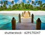 tropical white sandy beach.... | Shutterstock . vector #629170247