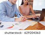 young man and woman working... | Shutterstock . vector #629204363