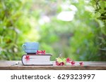 blue vintage cup and notebooks... | Shutterstock . vector #629323997
