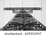 Small photo of A view from below on the power line post. Black and white.