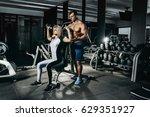 fitness instructor exercising... | Shutterstock . vector #629351927
