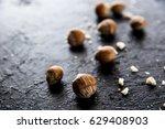nuts on a dark background | Shutterstock . vector #629408903