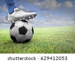 soccer player with his foot on... | Shutterstock . vector #629412053