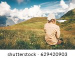 woman sitting on grass valley... | Shutterstock . vector #629420903