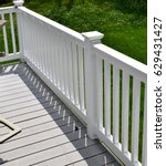 white vinyl fence and deck | Shutterstock . vector #629431427