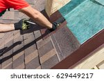 natural roof tile installation. ... | Shutterstock . vector #629449217