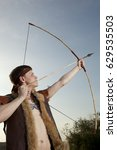 Small photo of Robin Hood. Young archer in vintage clothes with arrow and long bow