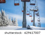 ski lift with skiers being... | Shutterstock . vector #629617007