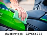 hand with man cleaning... | Shutterstock . vector #629666333