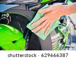 hand with man cleaning... | Shutterstock . vector #629666387