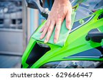 hand with man cleaning... | Shutterstock . vector #629666447