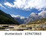 view of yulong mountain with... | Shutterstock . vector #629673863