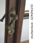 Small photo of Handle affixed to the door of the castle.