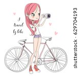 girl with a camera and bicycle | Shutterstock .eps vector #629704193