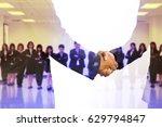 partners shaking hands . mixed... | Shutterstock . vector #629794847