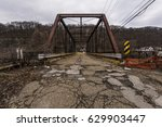 Small photo of A view of the abandoned Leet Street Pratt through truss bridge in Allegheny County, Pennsylvania.
