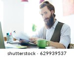 young man with documents... | Shutterstock . vector #629939537