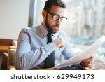 businessman reading agreement...   Shutterstock . vector #629949173
