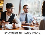 young colleagues discussing... | Shutterstock . vector #629949647