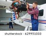 airplane service team repairing ... | Shutterstock . vector #629951033
