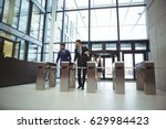 businesspeople scanning their... | Shutterstock . vector #629984423