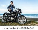 Man Smoking A Motorcycle Ridin...