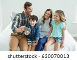 smiling man taking selfie with... | Shutterstock . vector #630070013
