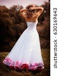 beautiful bride in white dress...   Shutterstock . vector #630169643