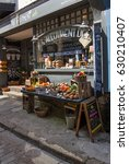 Small photo of ST IVES, CORNWALL. UK - APRIL, 18, 2017. The exterior of a traditional market store known as The Allotment Deli which sells fresh food on the cobbled streets of St Ives in Cornwall, UK.