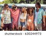 group of happy friends standing ... | Shutterstock . vector #630244973