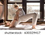 young yogi smiling mother doing ... | Shutterstock . vector #630329417
