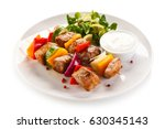grilled meat and vegetables  | Shutterstock . vector #630345143
