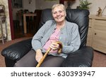 A Smiling Elderly Woman With A...
