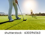 Low Angle View Of Golfer On...