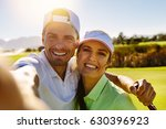 smiling male and female golfers ... | Shutterstock . vector #630396923