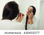 young woman in front of a...   Shutterstock . vector #630433277