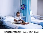 smiling girl drawing picture in ... | Shutterstock . vector #630454163