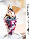 delicious blueberry ice cream | Shutterstock . vector #630470933
