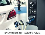 electric car charging on... | Shutterstock . vector #630597323