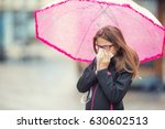 young girl with flu blowing her ... | Shutterstock . vector #630602513