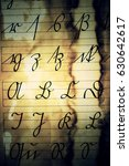 Small photo of Vintage Latin Alphabet Background